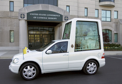 Pope Benedict XVI begins his popemobile trip from the headquarters of the United States Conference of Catholic Bishops in Washington to the Basilica of the National Shrine of the Immaculate Conception April 16 to greet Catholic leaders and meet with the U.S. bishops (CNS photo/Emily Thompson)