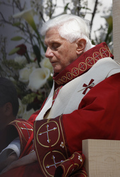 Pope Benedict XVI closes his eyes following Communion during Mass at Nationals Park in Washington April 17. (CNS/Nancy Wiechec)
