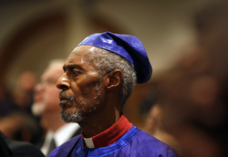 A clergyman attends an ecumenical prayer service with Pope Benedict XVI at St. Joseph's Church in New York April 18. (CNS photo/Nancy Wiechec)