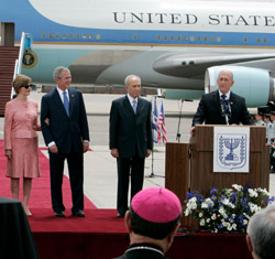 U.S. President George W. Bush and first lady Laura Bush are joined by Israeli President Shimon Peres, second from right, and Israeli Prime Minister Ehud Olmert, right, as they participate in an arrival ceremony at Ben-Gurion International Airport in Tel Aviv May 14. (CNS/Reuters)