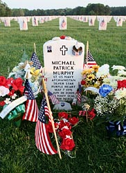 Flowers and flags decorate the grave of U.S. Navy Lt. Michael Patrick Murphy at Calverton National Cemetery in Calverton, N.Y., in 2006. Murphy was killed during a reconnaissance mission in Afghanistan in 2005. (CNS file/Gregory A. Shemitz)
