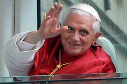 Pope Benedict XVI waves from his popemobile during a 2007 visit to the northern Italian city of Pavia. (CNS/Daniele Colarieti, Catholic Press Photo)