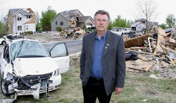 Mayor Fran Miron stands amid the devastation June 2 caused by a tornado that hit the community in Hugo, Minn., May 25. He has seen many examples of faith working in the lives of those affected by the devastation, including his own family.  (CNS/Dave Hrbacek, The Catholic Spirit)