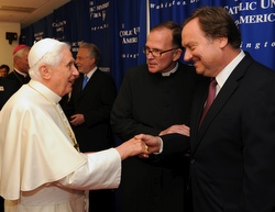 Pope Benedict XVI meets Tim Russert, NBC News Washington bureau chief and moderator of 'Meet the Press,' April 17 at The Catholic University of America in Washington. Father David M. O'Connell, center, president of the university, made the introduction during the pontiff's U.S. visit. (CNS/Tony Fiorini, courtesy of The Catholic University of America)