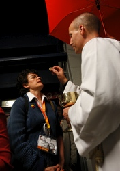 A priest distributes Communion to a woman at the opening Mass of the 49th International Eucharistic Congress in Quebec City June 15. (CNS/Nancy Wiechec)
