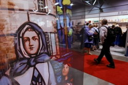 An image of St. Marguerite Bourgeoys greets visitors entering the exhibit hall at the 49th International Eucharistic Congress in Quebec City June 16. Born in France, St. Marguerite founded the Congregation of Notre Dame in Montreal in the 1650s. Along with a small group of women, she established and ran services and schools for colonists and the native inhabitants. (CNS/Nancy Wiechec)