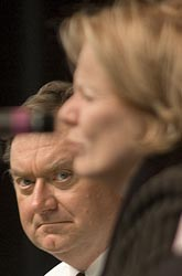 Tim Russert, managing editor and moderator of NBC's 'Meet the Press,' looks on as Peggy Noonan, a contributing editor to the Wall Street Journal and political author, speaks during a 2006 panel discussion at Boston College. (CNS photo/Peter Smith, The Pilot)