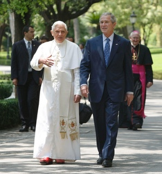 Pope and president walk in the Vatican Gardens. (CNS/Reuters)