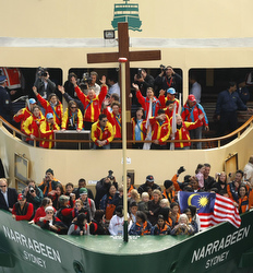 The World Youth Day cross is seen on the foredeck of a ferry as it nears the end of its Australian journey July 14 in Sydney. The cross, which had been carried thousands of miles across the continent, arrived at its final destination for the start of World Youth Day. (CNS/Reuters)