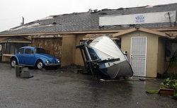 A boat is blown into a building by Hurricane Dolly in Port Isabel, Texas, July 23. Dolly slammed into the south Texas coast with punishing rain and winds of 100 mph, blowing down signs, peeling off roofs and knocking out power to thousands. (CNS/Reuters)