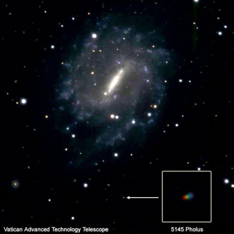 "The motion of small bodies in the solar system is still a subject of intense research. Observing the colors and spin of the comet/asteroid Pholus, Steve Tegler (Northern Arizona University) and Brother Guy Consolmagno took this image with the Vatican's telescope on Mount Graham, Ariz., as the object passed in front of the galaxy NGC 5964. We took three separate images in red, green and blue, and then combined them to make this image; since Pholus was moving between images, it appears as a rainbow ""streak"" in the image."