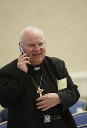 Bishop Michael P. Driscoll of Boise, Idaho, takes a call Nov. 10 before the start of the opening session of the U.S. bishops' meeting in Baltimore. (CNS/Nancy Wiechec)
