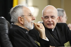 Cardinal Francis E. George of Chicago, right, president of the U.S. Conference of Catholic Bishops, talks with conference vice president Bishop Gerald F. Kicanas of Tucson, Ariz., Nov. 10 before the opening session of the U.S. bishops' general fall meeting in Baltimore. (CNS/Nancy Wiechec)