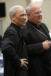Bishop John H. Ricard of Pensacola-Tallahassee, Fla., and Bishop Robert N. Lynch of St. Petersburg, Fla., attend the Nov. 11 session of the annual fall meeting of the U.S. Conference of Catholic Bishops in Baltimore. (CNS/Nancy Wiechec)