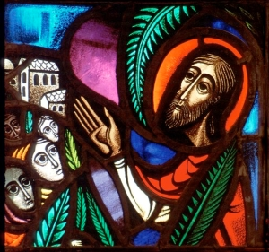 A stained glass image of Christ (CNS photo from Crosiers)
