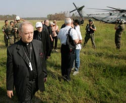 Archbishop (now Cardinal) Paul Cordes, left, and Cardinal Theodore E. McCarrick, retired archbishop of Washington, arrive in Biloxi, Miss., with other church officials for a 2005 tour of Mississippi areas devastated by Hurricane Katrina. (CNS/Bob Roller)