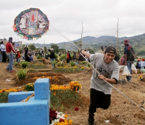 The celebration of the Dia de los Muertos, or Day of the Dead, throughout Latin America celebrates the lives of the deceased. In many places, people fly kites to help their friends and loved ones get to heaven. (CNS/Reuters)