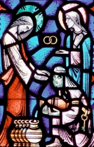 A church window depicts Jesus performing the miracle at Cana. (CNS photo from Crosiers)
