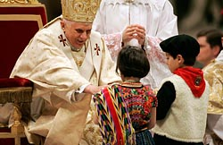 POPE BENEDICT BLESSES CHILDREN DURING MIDNIGHT MASS