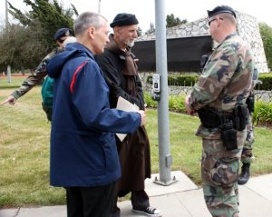 Jesuit Father Steve Kelly and Franciscan Father Louis Vitale talk with soldiers at Vandenberg Air Force Base just prior to their May 19, 2007 arrest for trespassing. (CNS/Los Angeles Catholic Worker)