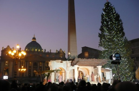 The Vatican's Nativity scene at dusk on Christmas Eve. (CNS photo by John Thavis.)