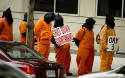Protesters against the Guantanamo Bay prison line up outside the transition office of U.S. President-elect Barack Obama in Washington Jan. 13. (CNS/Reuters)