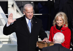 Joseph R. Biden, with his wife, Jill, holding the Bible, takes the oath of office as he is sworn in as vice president of the United States. (CNS/Reuters)