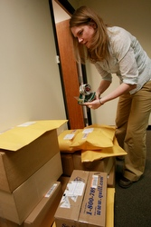 Theresa Bock prepares to ship boxes of pro-life literature and postcards at the office of the National Committee for a Human Life Amendment in Washington Jan. 26. Staff in the office were shipping boxes of literature and postcards to dioceses and others as part of a national campaign against the Freedom of Choice Act. (CNS/Paul Haring)