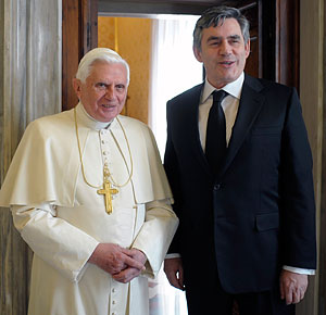 Pope Benedict XVI poses for a photo with Britain's Prime Minister Gordon Brown during their meeting at the Vatican Feb. 19.