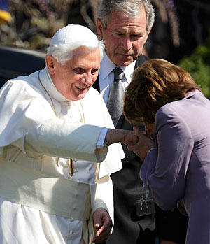 U.S. Speaker of the House Nancy Pelosi, seen with a rosary on her left wrist, kisses Pope Benedict XVI's ring during a welcoming ceremony for the pontiff on the South Lawn of the White House in Washington April 16, 2008.