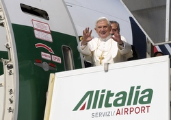 Pope Benedict XVI waves from the entrance of an airplane departing for Africa from Leonardo da Vinci International Airport in Rome March 17. (CNS/L'Osservatore Romano via Reuters)