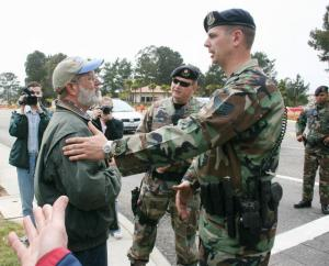 Dennis Apel of the Guadalupe Catholic Worker talks with a military police sergeant prior to his arrest during a peace vigil at Vandenberg Air Force Base in California May 19, 2007. (CNS/Los Angeles Catholic Worker)
