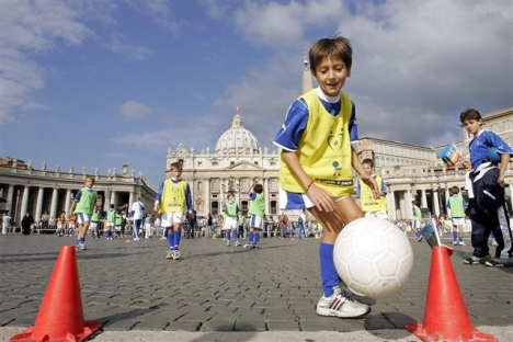 Children play soccer in St. Peter's Square at the Vatican before the weekly audience of Pope Benedict XVI in this Sept. 21, 2005. (CNS photo/Alessia Giuliani, Catholic Press Photo)