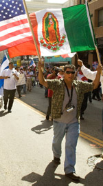 A man holds a U.S. and Mexican flag during an immigration rally in downtown Los Angeles. (CNS/Victor Aleman, Vida Nueva)