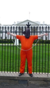 "Catholic peace activist Paul Magno was arrested soon after he was chained to the White House fence in a ""contemporary crucifixion"" Good Friday as part of a campaign to close the military prison at Guantanamo Bay, Cuba."