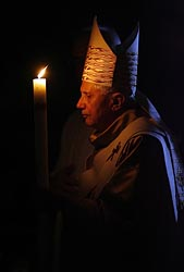 POPE HOLDS CANDLE AS HE CELEBRATES EASTER VIGIL