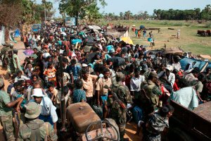 This photograph released by the Sri Lankan military May 15 shows what the army says are civilians fleeing from the area inside a no-fire zone held by Tamil separatists. (CNS photo/Sri Lankan Government, Reuters)