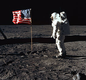 "Astronaut Edwin ""Buzz"" Aldrin poses for a photo beside the U.S. flag during the first manned lunar landing in 1969. Pope Paul VI told astronaut Neil Armstrong that he was right on the mark in describing the Apollo 11 mission as ""one giant leap for mankind."" (NASA)"