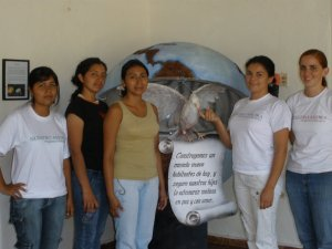 Victoria Cavanaugh, far right, with four university students from Nuestro Ahora. (CNS/Nuestro Ahora)