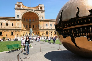 VISITORS STROLL THROUGH COURTYARD OF VATICAN MUSEUMS