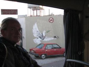 A peace dove painted by local Palestinians on the security wall. (Photo courtesy Father Tom Holahan)