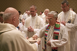 Cardinal Francis E. George of Chicago, president of the U.S. Conference of Catholic Bishops, gives Communion to U.S. bishops during Mass at the opening of the bishops' annual fall meeting in Baltimore this morning. (CNS/Bob Roller)