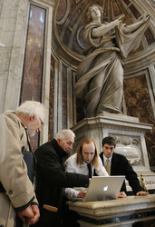 The Villanova team checks images they shot in January in St. Peter's Basilica. (CNS/Paul Haring)