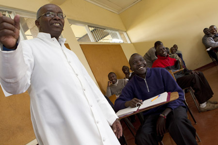 Father Joseph Njoroge Ngugi quizzes seminarian Samuel Lima on his Greek lesson during a class at St. Thomas Aquinas Seminary in Nairobi. (CNS/Nancy Wiechec)