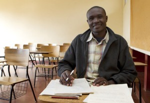 Fourth-year theology student Richard Odhiambo is among the 125 men studying for the priesthood at St. Thomas Aquinas Seminary in Nairobi. Odhiambo looked up for a photo while studying for an exam in moral theology. (CNS/Nancy Wiechec)