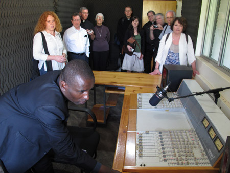 Father Martin Wanyoike, director of the Kenyan Catholic bishops' Radio Waumini, shows diocesan directors of the Pontifical Mission Societies in the United States around his studio in Nairobi. (CNS/Msgr. John E. Kozar)