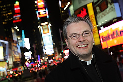 Father Richard Baker, pastor of New York's St. Malachy's Church - The Actors' Chapel, is shown in New York's Times Square in 2010. St. Malachy's is located down the block from Broadway and serves people in the theater district. (CNS/Gregory A. Shemitz)