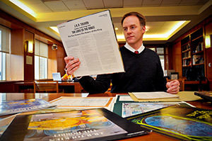 Marquette archivist William Fliss looks over material related to Tolkien collection. (Catholic Herald photo by Juan C. Medina)