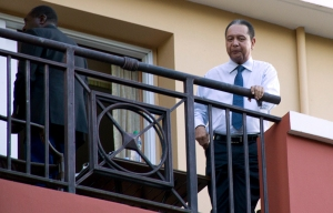 "Jean-Claude ""Baby Doc"" Duvalier, shown in 2011 waving from a hotel balcony, has been ordered to court for a hearing on whether he will face charges for human rights abuses during his brutal 15-year dictatorship. (CNS photo/Retuers)"