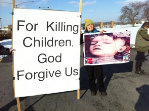 Ellen Grady, a Catholic Worker from Ithaca, N.Y., peacefully protests drone warfare outside of Hancock AIr National Guard Base near Syracuse on Ash Wednesday. (Courtesy Upstate New York Coalition to Ground the Drones)
